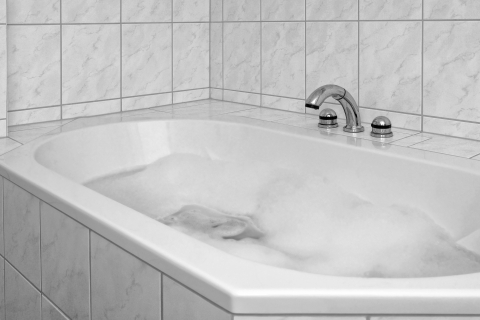Bathtub Surrounded by Clean White Tile