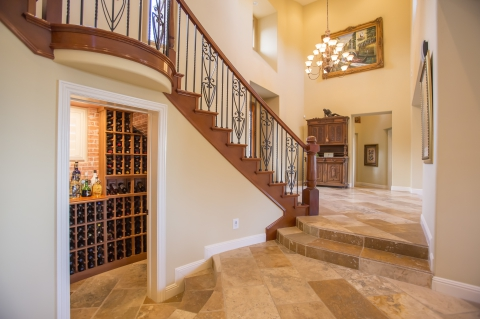 Home Entryway With Inviting Tan Tile