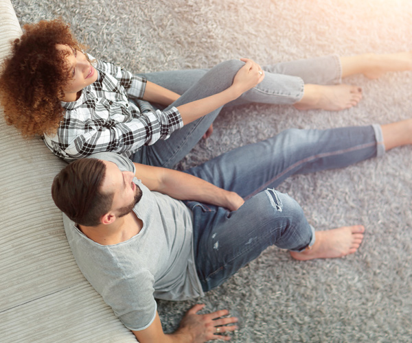 Couple Enjoying Lush Carpet