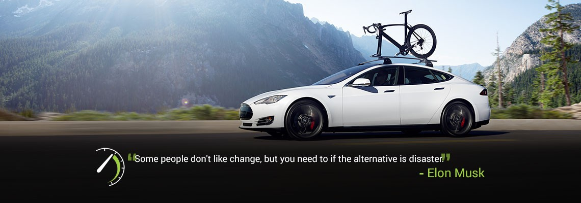 A white Tesla Model S fitted with a bike rack.