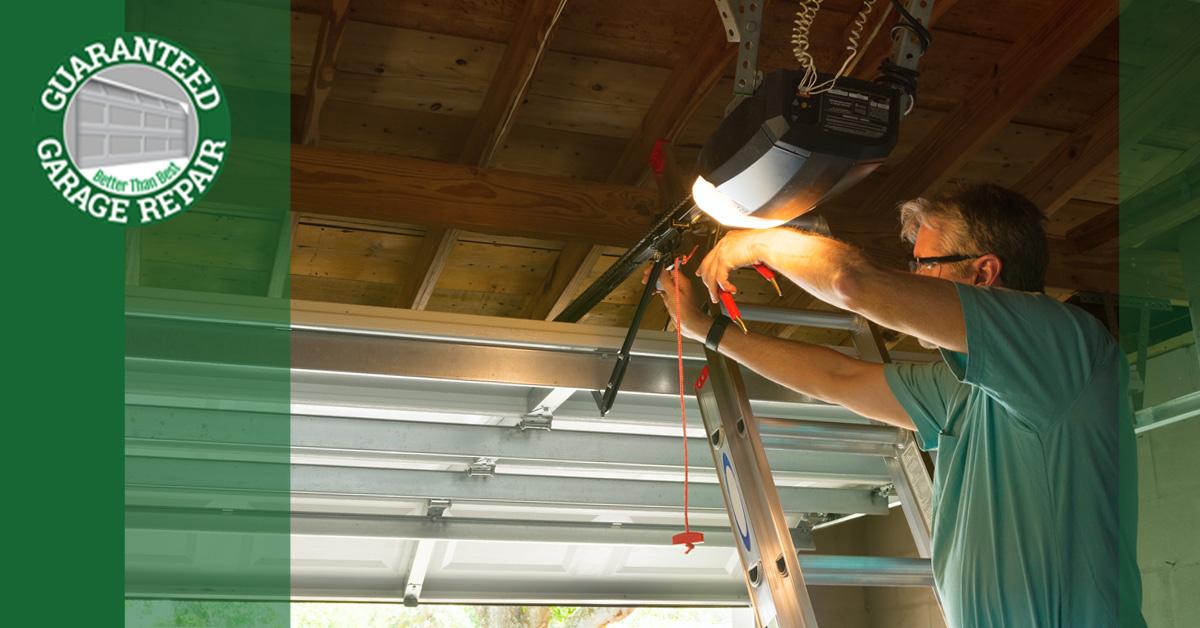 A man adjusting the chain on a garage door opener.