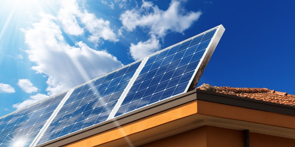 Solar panels on a roof on a sunny day.