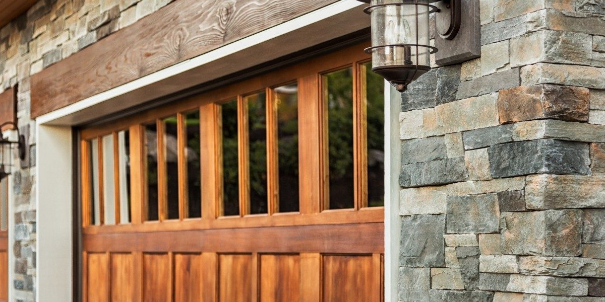 An image of a wood garage door with windows inset into a rough hewn stone wall.
