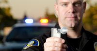 Officer Holding a Breathalyzer