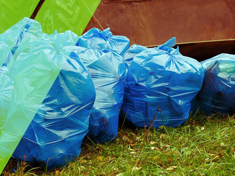 Multiple blue trash bags.