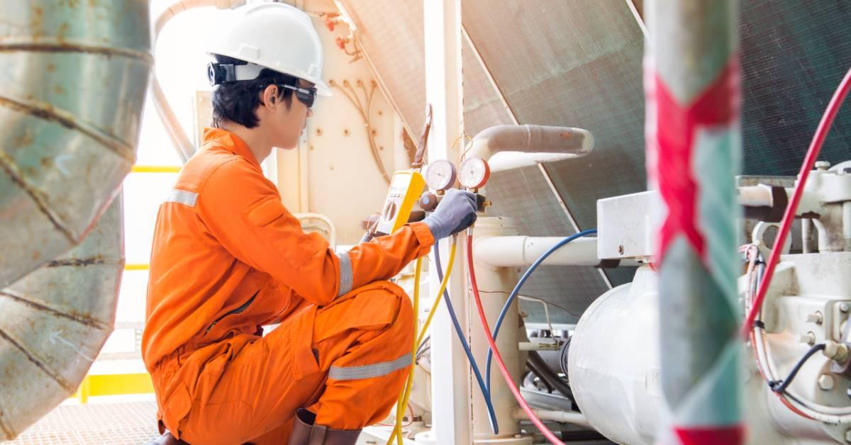 An image of an HVAC technician.