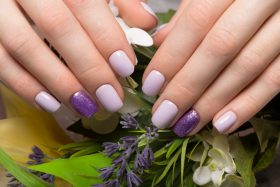 manicured hands held closely together, like at Herbal Nair Bar!