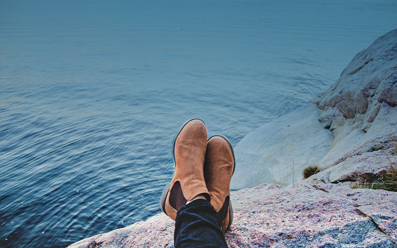 shoes on ledge of cliff