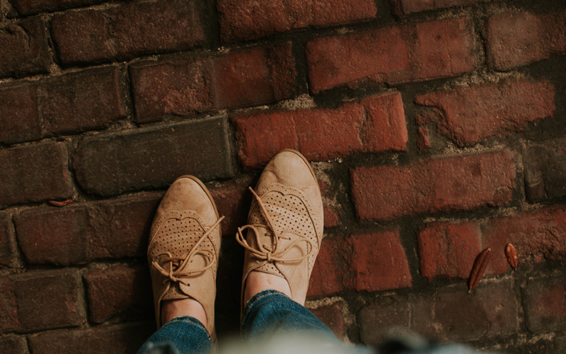 Tan shoes on brick path