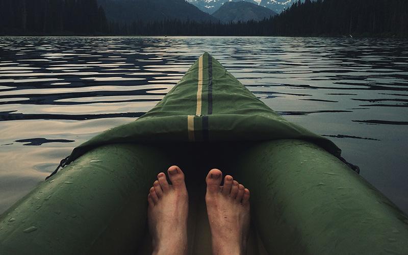 Bare feet in a canoe