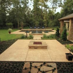 Backyard and patio with fire pit and custom pool - Hipp Pools