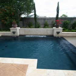 Backyard with custom pool and stone patio - Hipp Pools