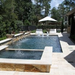 Courtyard with raised and inground pool with water features - Hipp Pools