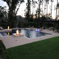 Backyard with patio, custom pool, and fire features - Hipp Pools