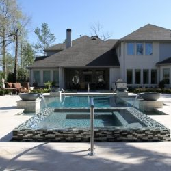 Backyard and house with custom pool - Hipp Pools