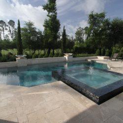 Backyard with stone decking and custom pool - Hipp Pools