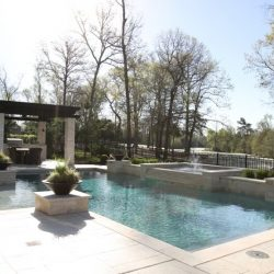 Geometric custom pool with water features and accent architecture - Hipp Pools