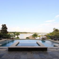 Luxurious back yard with pool overlooking a lake - Hipp Pools