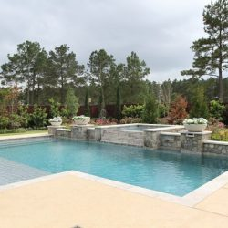 Courtyard with large custom pool, water features, and landscaping - Hipp Pools