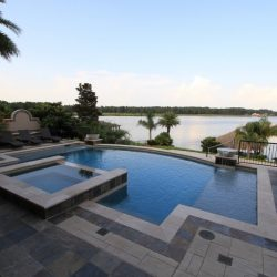 Multi-layered custom pool overlooking a lake - Hipp Pools
