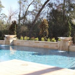 Custom pool with steps and water fountains - Hipp Pools