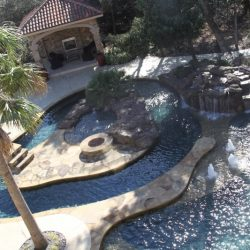 Aerial view of unique custom pool and rock waterfall - Hipp Pools