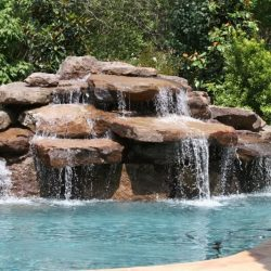 Rocks with waterfall flowing into a pool - Hipp Pools