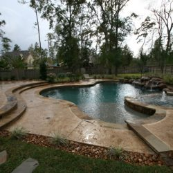Back patio with steps, custom pool and landscaping - Hipp Pools