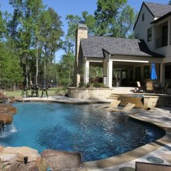 Backyard with custom pool and large rock waterfall - Hipp Pools