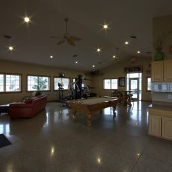 The glossy flooring and nice light wood cabinets in the apartment clubhouse.