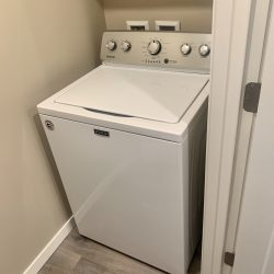 An in-unit apartment washer and dryer set.