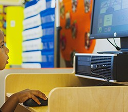 We incorporate computer learning into our day care program!