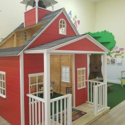 Red playhouse at Home Away From Home's West Boynton Beach daycare center