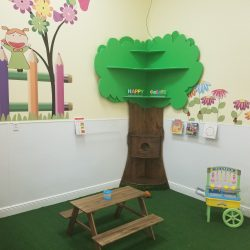 Play area with tree and wall murals - Home Away From Home West Boynton Beach daycare location