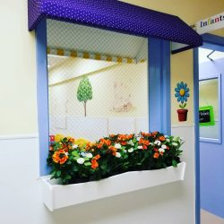 Fun window with flowers - Home Away From Home West Boynton Beach daycare location