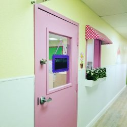 Pink door and window with flowers - Home Away From Home West Boynton Beach daycare location