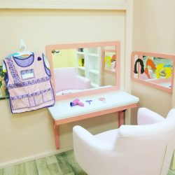 Play area with girl's vanity and toys - Home Away From Home West Boynton Beach daycare location