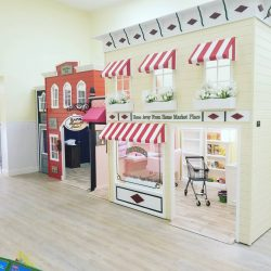 Play area with grocery store and fire department - Home Away From Home West Boynton Beach daycare location