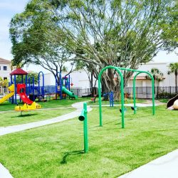 Outside playground with swings and slides - Home Away From Home West Boynton Beach daycare location