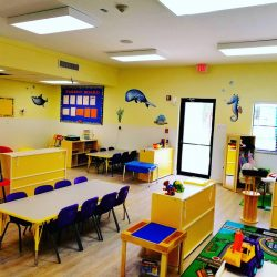 Room with kids' tables and toys - Home Away From Home West Boynton Beach daycare location