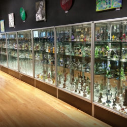 Wall of glass pipes at Witch Dr. Glass Blowing Studio in Massachusetts