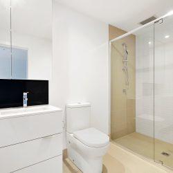 sink, toilet, shower in white bathroom