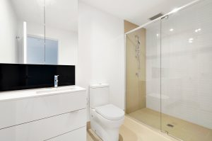 sink, toilet, shower in white bathroom