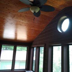 ceiling fan on cedar ceiling