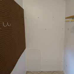 empty closet with pegboard