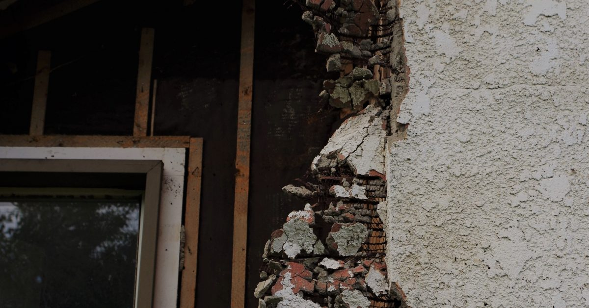 window frame and partially demoed wall
