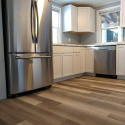 vinyl plank floors with new stainless steel appliances