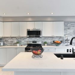 white kitchen counter with white cabinets