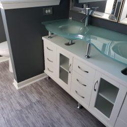 brushed white flooring in bathroom
