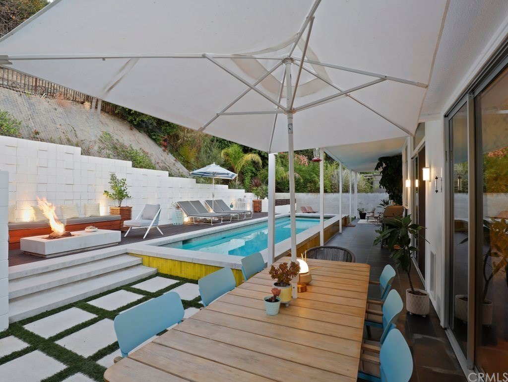 outdoor dining area by pool